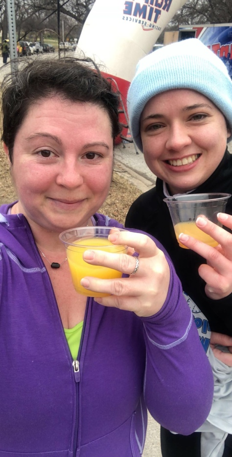 Me and Amanda drinking mimosas by the finish line